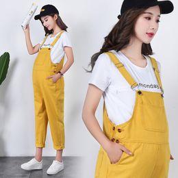 404e4c6a417b Yellow Cotton Denim Maternity Jumpsuits for Four Season Wear Bib Pants  Clothes for Pregnant Women Pregnancy Overalls Jeans