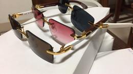 Óculos escuros em madeira on-line-Sem aro luxo óculos de sol chifre de búfalo óculos com moldura de madeira pernas dos homens das mulheres óculos de sol para a marca designer de melhor qualidade com caixa