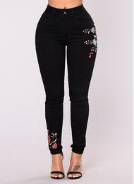 Длинные цветочные джинсы онлайн-Women Floral Print Black Jeans Sexy Slim Fashion Denim Long Pants Jeans Women Clothes Streewear Skinny Jeans Free Shipping