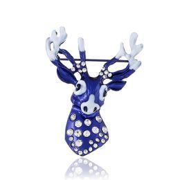 Joyería azul campana online-Nueva cabeza de ciervo de cristal azul cabeza de venado Venta al por mayor Mental Navidad Mujeres niños navidad campana Joyería Regalos Broche