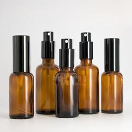 2019 vaporisateur de bouteilles de parfum Bouteilles ambres de 30ML / 50ML avec des bouteilles de jet en verre de couvercle noir pour la bouteille de parfum de pompe d'atomiseur de pulvérisateur de brume d'échantillon d'huiles essentielles vaporisateur de bouteilles de parfum pas cher
