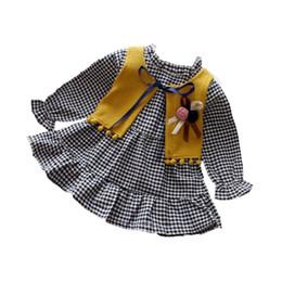 Säuglingsmädchenkleid 2018 Frühling und Herbst neues böhmisches Art niedliches kleines Plaid langärmliges Kleidweste zweiteilige Klage von Fabrikanten