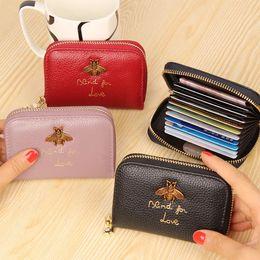 Canada femme en cuir véritable portefeuilles abeille décoration marque portefeuille court sac à main porte-cartes en gros designer sac à main portefeuille Offre