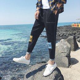Wholesale 2018 Fashion Casual Slim Fit hip hop letter color cloth patch  harem pants men joker loose black blue teenagers jeans 8638de010