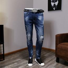 f6066e665fd Social guy jeans feet pants handsome European station men s pants trousers  scraped hole jeans