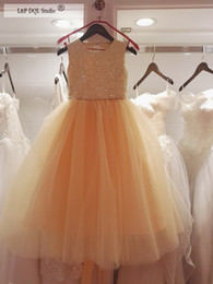 Wholesale Ruffle Bottom Wedding Dresses - 2018 Flower Girls Dresses Champagne tulle Bottom Gold Sequins Top Sleveless Ball Gown Floor-Length with Bow Girls Party Dress