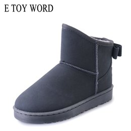 2019 botas clásicas de piel de oveja E TOY WORD Sheepskin Fur one botas de nieve para mujer nudo de mariposa Mujer plana Botines impermeables Zapatos de invierno Moda clásica rebajas botas clásicas de piel de oveja