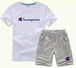 мальчик фотографии Марка детские наборы детская футболка и шорты брюки детские спортивные костюмы дети спортивный костюм 2 шт. с коротким рукавом от