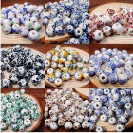 XINYAO 50 pz / lotto 10mm Grande Grande Foro Perle di Ceramica Fiore Blu E Bianco Perline di Porcellana Handmade Gioielli FAI DA TE Fare Accessori da
