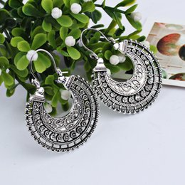 Wholesale carved jade charms - European Major Suit Ancient Silver Nation Wind Earrings Restore Ancient Ways Alloy Weave Form A Basket Of Flowers Exaggeration Carving Ear