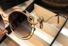 pequeños espejos enmarcados Rebajas Diseñador de moda clásico gafas de sol 1024 retro marco de metal patas de espejo de serpiente con un pequeño diamante estilo popular uv 400 gafas para exteriores