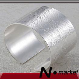 Anelli di tovagliolo cinese online-Nuovi anelli portatovaglioli in lega cinese per tovaglioli intagliati in argento