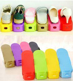 Zapatos ajustables de plástico creativo Organizador del estante Ahorro de espacio Ranuras para zapatos de almacenamiento Eco amigable Conveniente 12 colores desde fabricantes