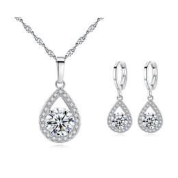 Cristales Chispeantes de alta calidad Cluster Big CZ Teardrop Hoop Pendientes Collar Colgante Moda Para Mujer Conjuntos de Joyería para la Boda del partido desde fabricantes