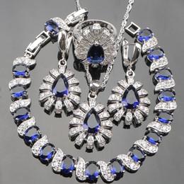 Cz 925 anillo de porcelana online-China Piedras Azules Blanco CZ 925 Joyas de Plata Esterlina Establece Para Las Mujeres Pendientes Collar Colgante Pulseras Anillos