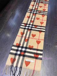 Canada Nouvelle marque hommes et femmes long style de laine 180 * 30CM longue laine douce imprimée écharpe de marque coeur de pêche avec des étiquettes Offre