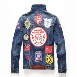 14becd4b846 High quality New Blue Men s Hole Embroidery Badge Patchwork Denim Jacket  fashion Jeans Jackets casual streetwear Vintage Mens jean clothing