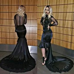 sirena nera di sirena a basso indietro Sconti Africano Sexy Nero High Low Mermaid Prom Dresses 2018 Sheer Manica Lunga Pizzo Appliqued Paillettes Illusion Corpetto Abiti Da Sera Lunghi BA8076