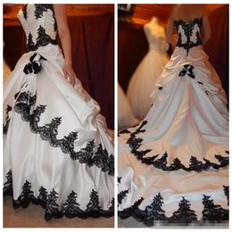e15c79e5776a 2018 Sweetheart Gothic Lace Applique Tiered White And Black Bridal Dress  Long Back Lace Up Satin Elegant Bridal Wedding Gowns Draped