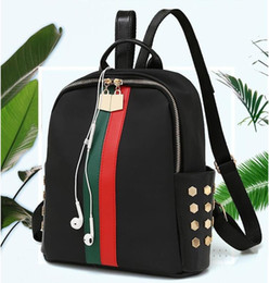 0b3a9a3799f9 2018 new fashion Korean version of the tide waterproof Oxford spinning mini  wild small backpack star with shoulder bag handbag
