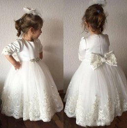 Wholesale flower tires - 2018 White Cute Lace Princess Ball Gown Cheap Flower Girl Dresses Jewel 3 4 Long sleeve Zipper with bow Tulle Tired Skirts Communion Dresses