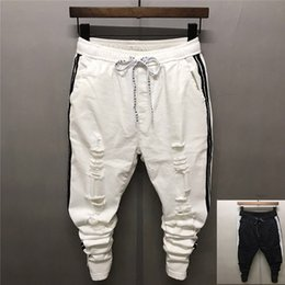 12e4b0e8543a 2018 Summer Two Bars Ankle-Length Ripped Men s Jeans White Slim Casual  South Korea Social Personality Pencil Pants Lightweight