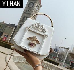La borsa delle donne di marca della fabbrica dolce e bella decorazione della borsa delle donne della collana di angelo delle donne di tendenza e la borsa di cuoio delle donne di arte modellano supplier brand handbags factory da fabbrica di borse di marca fornitori