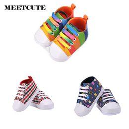 fb4e2e4668b50 Vente en gros- MEETCUTE New Baby Baby mignon toile toile baskets Rainbow  Star Grid Pattern Premier Walker Bottes Infant Soft Bottom Chaussures