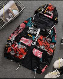 2019 suéter de navidad rojo para mujer Ms Desgaste de doble cara Abrigo de camuflaje Versión coreana Moda impresa gabardina Casual running top nuevo estilo al por mayor