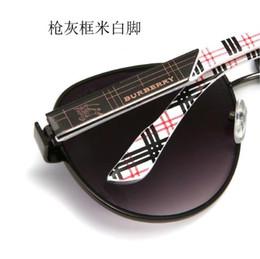 Occhiali da sole eleganti per gli uomini online-montatura classica in metallo Occhiali da sole da donna marchio di lusso per il design di guida Eleganti occhiali da sole