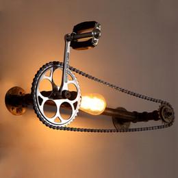 Luces de bicicleta de época online-loft lámpara de pared de tubo de agua vintage E27 Edison bicicleta rueda engranaje cadena luz de pared para restaurante bar cafetería pub dormitorio livng sala de escalera
