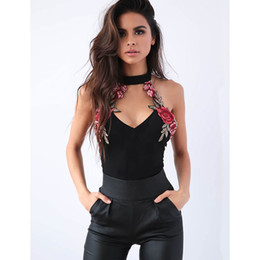 0a4c0ea7687 Sexy Women V-Neck Bodycon Bandage Sleeveless Sleeveless Floral PU Pants  Jumpsuit Evening Party Clothes Women s Jumpsuit
