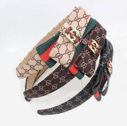 Vintage hecho a mano rojo verde a rayas Bowknot Hairband letras de la marca g venda de la tela bandas para el cabello mujeres chica pelo accesorio de la joyería desde fabricantes