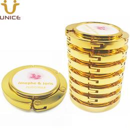 MOQ 100pcs misura di MARCHIO d'oro gancio del sacchetto di colore dell'oro magnetica pieghevole della borsa del gancio della Tabella del supporto della borsa del regalo di nozze di bellezza da eye makeup brush sets fornitori