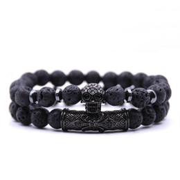 Conjunto de joyas de turquesa online-Venta caliente 2 unids / set Negro color cráneo Cabeza Lava Turquesa Natural Stone Beads Hombres Pulsera Conjunto de Joyas brazaletes del encanto