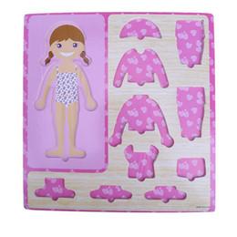 Juguetes de madera para bebés Niños Niñas Vestido Changing Jigsaw Clothing Matching Wooden Puzzle Board Niños Juguetes educativos Regalo de Navidad desde fabricantes
