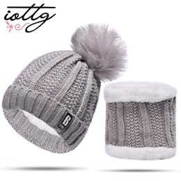IOTTG 2018 New Pom Poms Winter Hat for Women Fashion Solid Warm Hat Knitted  Beanies Cap Brand Thick Female Caps 6ef4be45003c