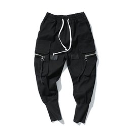 Cintura elástica calças longas on-line-Calças Harem Loose Mens Hip Hop Calças Compridas Jeans KANYE WEST Streetwear Moda Jeans Elástico Na Cintura Preto Jeans High Street