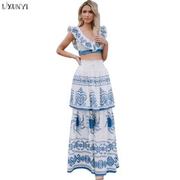 934ce80747f LXUNYI Summer Sexy 2 piece outfits for Women Floral Print V Neck Crop Tops  and Skirt Set two Piece Beach Clothing Sets