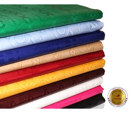 Buena calidad África Occidental Bazin Riche Guinea Brocade tela de algodón ropa africana textil para el banquete de boda Feitex desde fabricantes