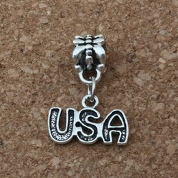 wholesale beads usa Promo Codes - MIC .200pcs lot Dangle Antiqued Silver Alloy Single-sided USA Charm Big Hole Bead Fit Charm Bracelet Jewelry 15.5x23mm A-169a