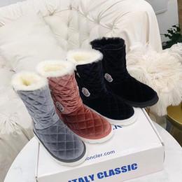 Bottes de neige pour hommes et femmes Français marque de luxe de fourrure une botte courte en duvet d'oie chaussures pour enfants designer d'origine ? partir de fabricateur