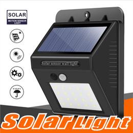 20 LED Güneş Sensörü Duvar ışık Hareket Sensörü Powered Duvar ışık Out Kapı Ev bahçe Duvar ışıkları Gece Güvenlik Lambası Kutusu ile Oluk oluk nereden güneş enerjili güvenlik aydınlatması tedarikçiler