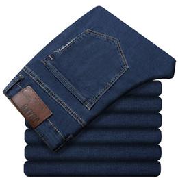 2018 Brand Mens Elasticity Loose Jeans Business Casual Slim Thin Jeans Classic Pantalones de mezclilla de gran tamaño 44 46 48 desde fabricantes