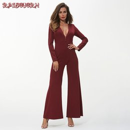 cfff0fabe21 RAISEVERN Deep V-neck Women Sexy Jumpsuits Elegant Long Sleeves Wide Leg  Rompers Red black Autumn Office Ladies Fashion Clothing