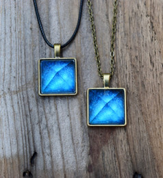 Wholesale Pyramid Chains - 12pcs lot Glowing Crystal Glow in the Dark Pyramid Pendant Outer Space Star Dust Necklace Triangle Geometric Magic Necklace