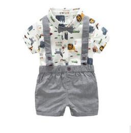 Pantaloncini bianchi online-000 2018 Summer Boys Harness Bib Set Short Shorts manica Due pezzi Little Monster stampa bianco coreano adatto per 1-3 anni