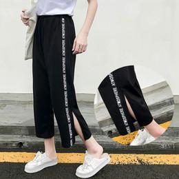 d5b82e4840a1 Side Striped Letter Loose Harajuku Wide Leg Pants Women Trousers Split  Streetwear Hip Hop Harem Femme Bts Kpop Korean Pantalones C18111301