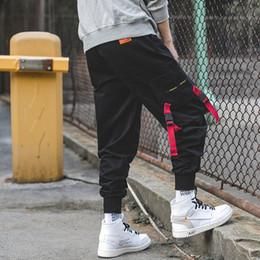 Nuevo diseño de pantalón de carga online-Cintas Bolsillos Pantalones de harén Hombres Otoño Invierno Harajuku Pantalones de chándal Casual Estilo hip hop Joggers de calle Nuevo diseño Slim Fit Lápiz Pantalones