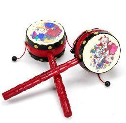 tambores de brinquedo chineses Desconto Bebê crianças dos desenhos animados de plástico chinês tradicional chocalho tambor spin brinquedos divertidos sino de mão música brinquedos